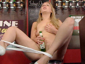 Aston Wilde enjoys a long cool beer on her clit