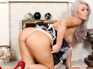 Luci Jones as a naughty house maid by the fire