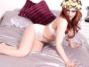 Georgia Brown on the bed in white lacy panties