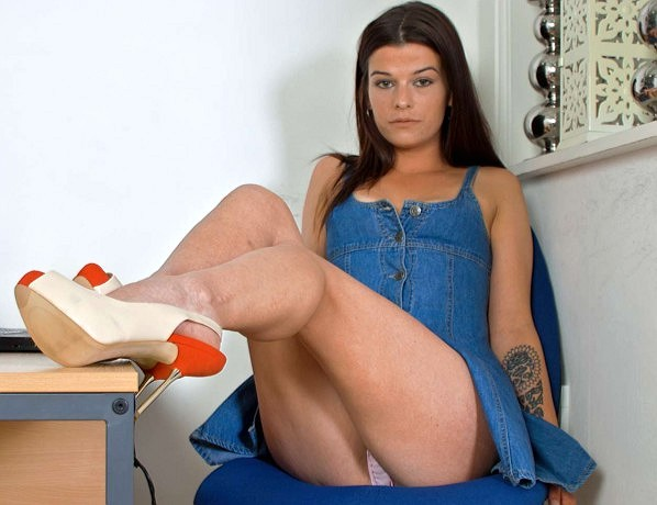 Office girl Amy Bond in heels and pink sheer panties